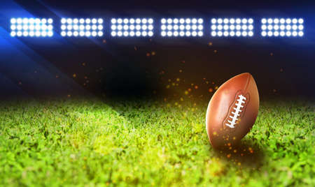 Leather American ball on green football field, space for text. Banner design