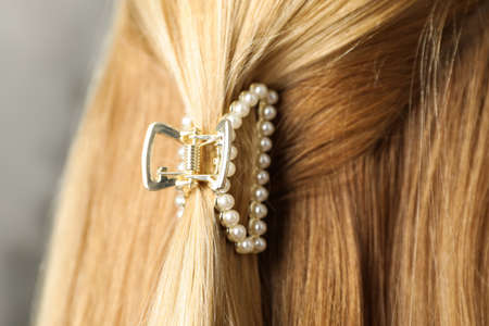 Woman with beautiful hair claw, closeup view