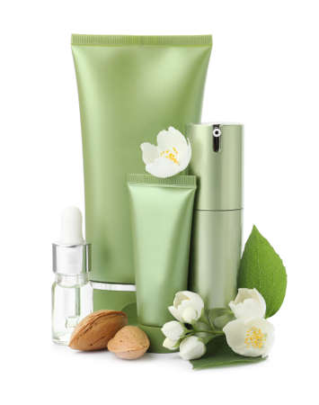 Set of cosmetic products, almond nuts and flowers isolated on white Archivio Fotografico