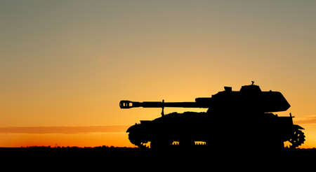 Silhouette of army tank at sunset outdoors. Military machinery Zdjęcie Seryjne