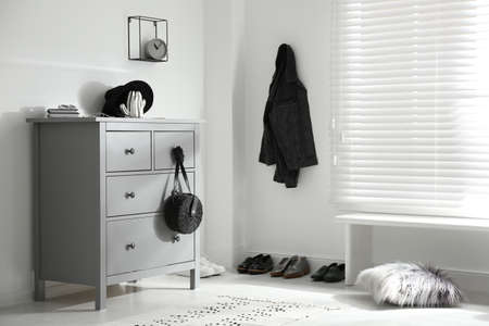 Grey chest of drawers in stylish room. Interior design Stockfoto