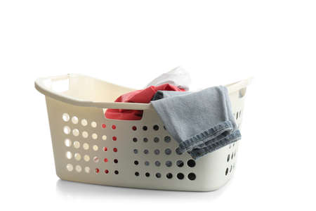 Laundry basket with clothes isolated on white