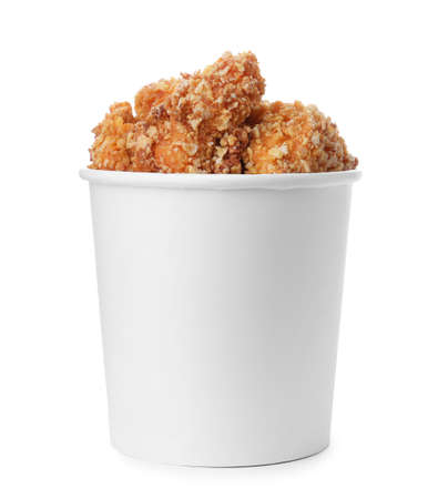 Bucket with yummy fried nuggets isolated on white