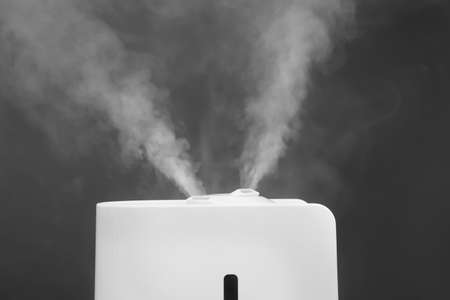Modern air humidifier on grey background, closeup