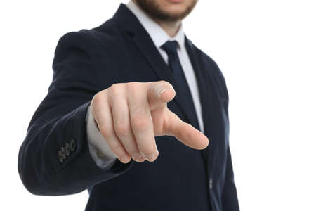Businessman touching something against white background, focus on hand Banque d'images - 150811570