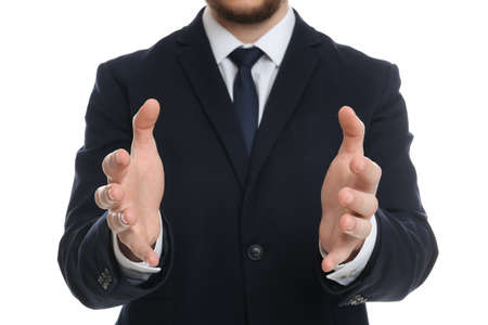 Businessman holding something against white background, focus on hands