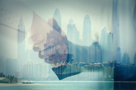 Double exposure of partners shaking hands and city. Business values