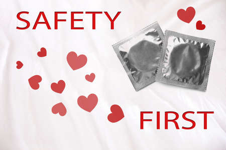 Safety first. Silver condom packages on color background, top view
