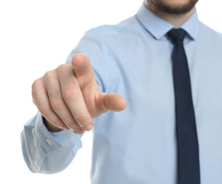 Businessman touching something against white background, focus on hand Banque d'images - 150812723