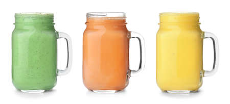 Set of different fresh tasty smoothies on white background