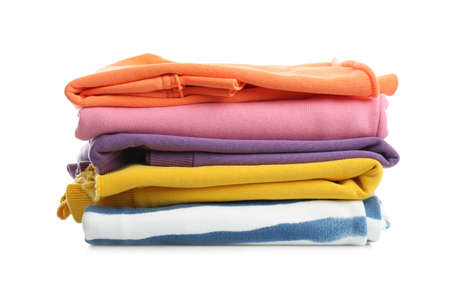 Stack of folded clothes isolated on white