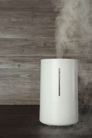 New modern air humidifier on wooden table