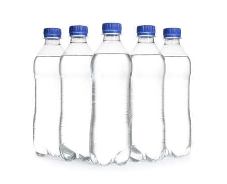 Plastic bottles with pure water on white background
