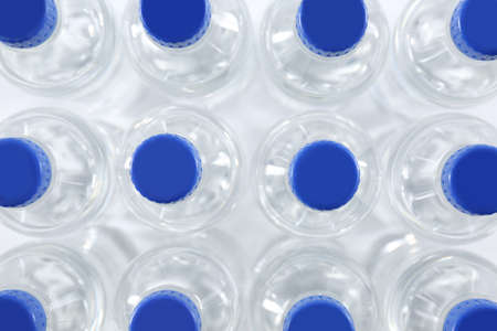 Plastic bottles with pure water as background, top view Imagens