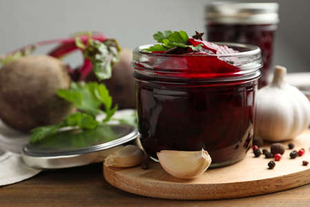 Delicious pickled beets and spices on wooden table Stock Photo