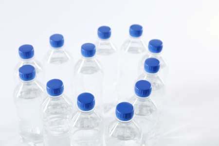 Heart made with plastic bottles of pure water on white background Imagens