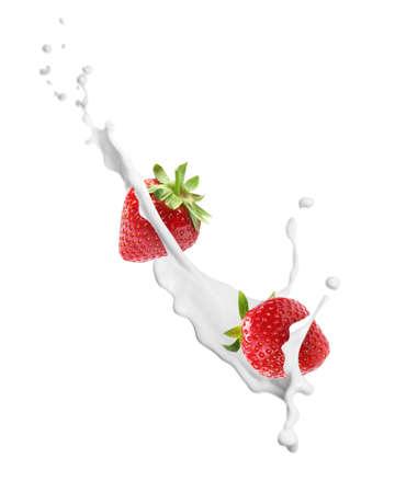 Fresh strawberries with milk splash on white background