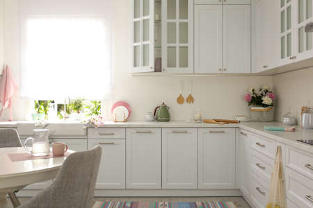 Beautiful kitchen interior with new stylish furniture Banque d'images - 151149796