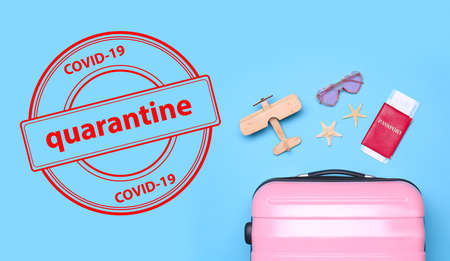 Closure of air traffic during coronavirus outbreak. Toy airplane, beach supplies and stamp with inscription QUARANTINE , flat lay