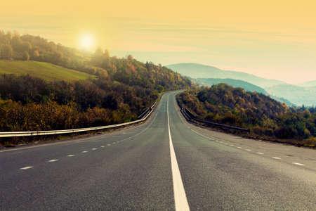 Road trip. Beautiful view of asphalt highway at sunset