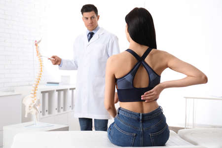 Young woman visiting orthopedist in medical office