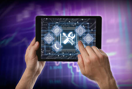 Man using tablet on color background, closeup. Technical support