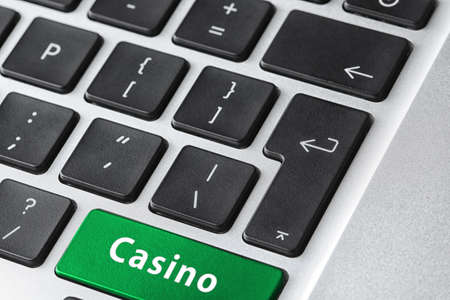 Laptop keyboard with button Casino, closeup. Online games concept