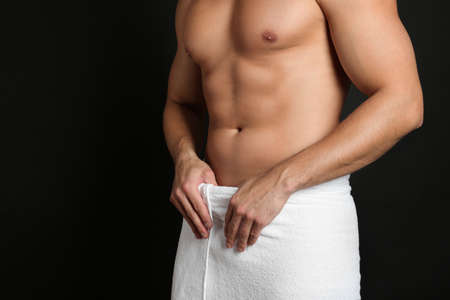 Man with sexy body on black background, closeup