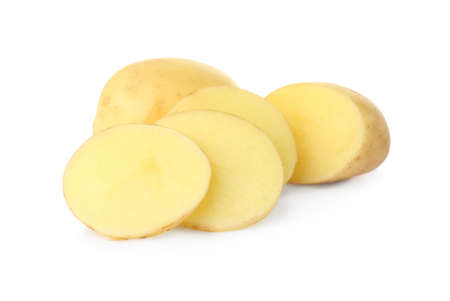 Whole and cut fresh raw organic potatoes on white background