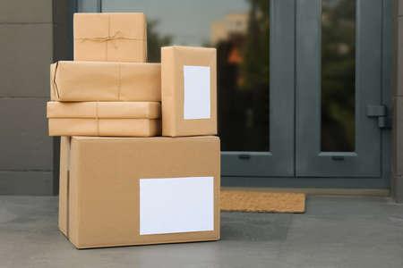 Cardboard boxes near door. Parcel delivery service