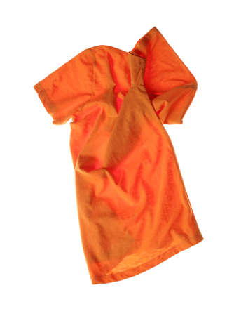 Rumpled orange t-shirt isolated on white. Messy clothes