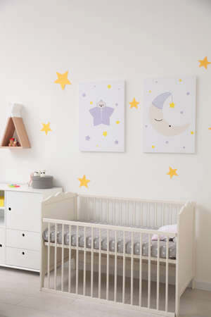 Stylish baby room interior with crib and decor elements Stock fotó