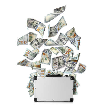Modern suitcase full of money and flying American banknotes on white background Banque d'images