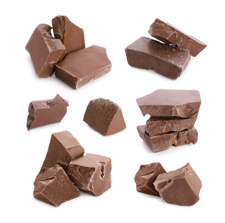 Set with pieces of delicious chocolate on white background