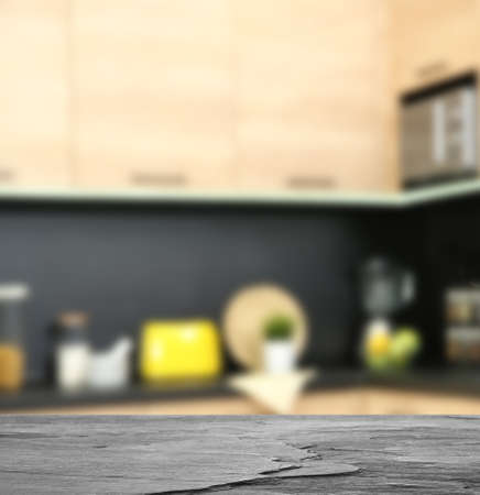 Empty black stone table in modern kitchen interior