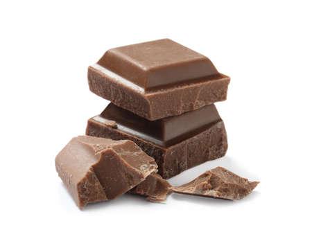 Pieces of delicious milk chocolate isolated on white Stockfoto
