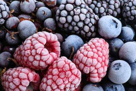 Mix of different frozen berries as background, top view 版權商用圖片