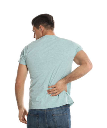 Man suffering from lower back pain on white background. Visiting orthopedist Stock Photo