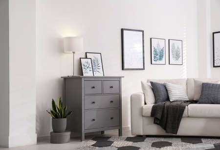 Modern room interior with gray chest of drawers