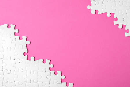 Blank white puzzle pieces on pink background, flat lay. Space for text