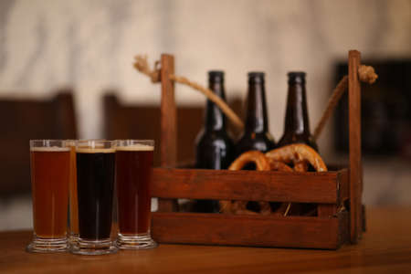 Beer tasting set served on wooden table