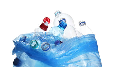 Blue bag with used bottles isolated on white. Plastic recycling