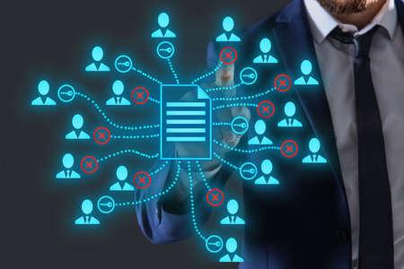 Access to documents. Man using virtual screen with scheme, closeup Standard-Bild