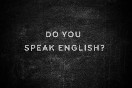 Black chalkboard with text Do You Speak English