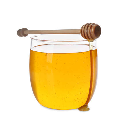 Fresh honey in jar and dipper on white background