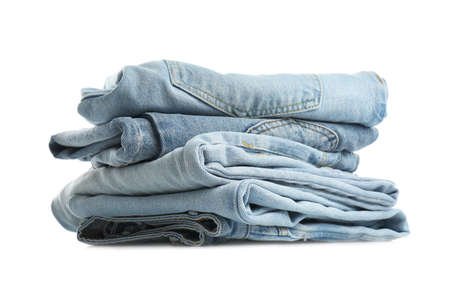 Stack of folded jeans isolated on white Standard-Bild
