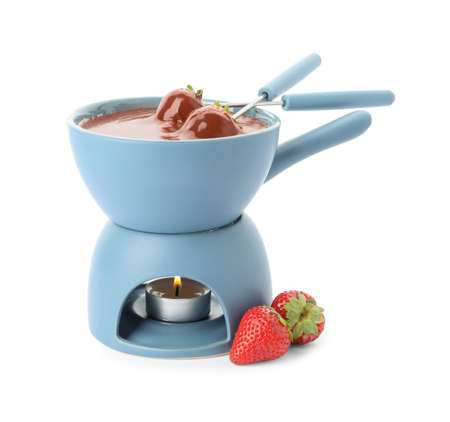 Fondue pot with chocolate and fresh strawberries isolated on white