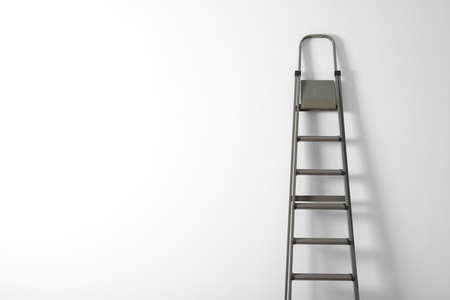 Metal stepladder on white background. Space for text
