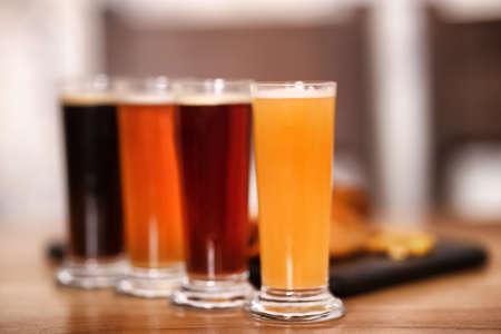Beer tasting set served on wooden table
