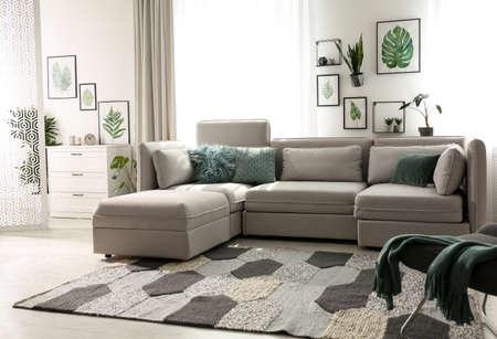 Comfortable large sofa in light room. Interior design